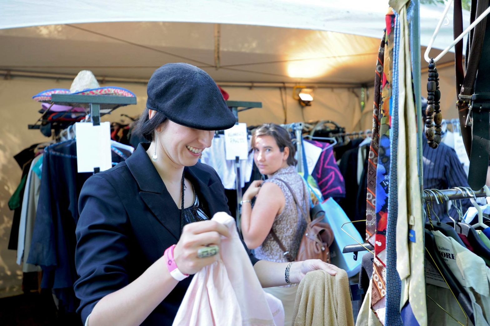 Photo of two people at a clothing swap. Photo courtesy The Gender Spectrum Collection through a Creative Commons license.